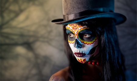 Sugar skull girl in tophat, in the forest Stock Photo - Budget Royalty-Free & Subscription, Code: 400-05726041