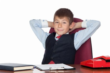 Little businessman relaxed in the office isolated on a over white background Stock Photo - Budget Royalty-Free & Subscription, Code: 400-05720053