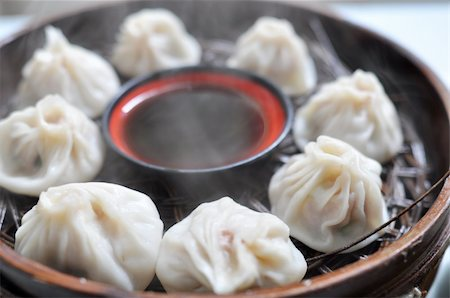 dumplings steamer - A plate of steamed dumplings in Xian, China Stock Photo - Budget Royalty-Free & Subscription, Code: 400-05721474
