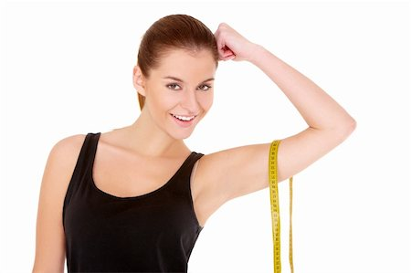 Fitness woman with measure tape on white background Stock Photo - Budget Royalty-Free & Subscription, Code: 400-05734534