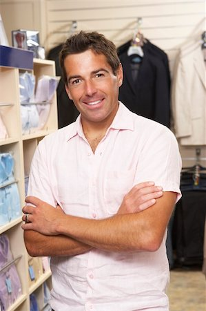 Male sales assistant in clothing store Stock Photo - Budget Royalty-Free & Subscription, Code: 400-05735354