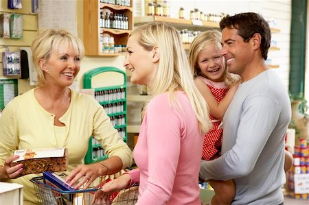 Female sales assistant in health food store Stock Photo - Budget Royalty-Free & Subscription, Code: 400-05735395