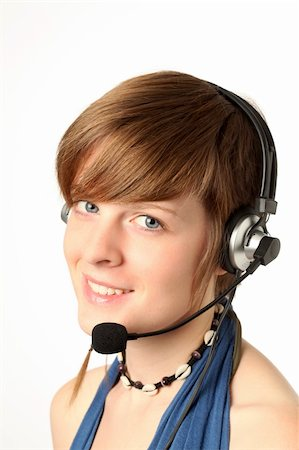 rainerplendl - young woman with a headset smilling Stock Photo - Budget Royalty-Free & Subscription, Code: 400-05735739