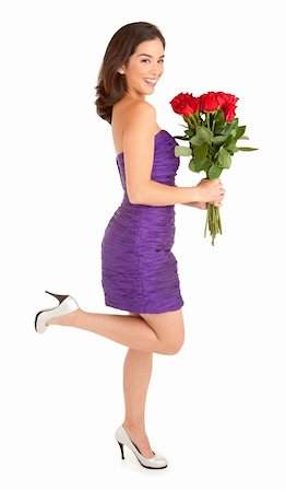 dozen roses - Woman in an evening dress is happily holding roses she just received Stock Photo - Budget Royalty-Free & Subscription, Code: 400-05739030