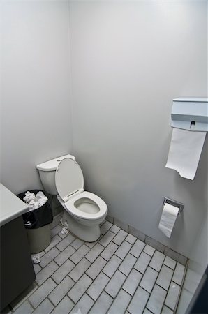 A toilet, sink and waste basket in an office washroom. Stock Photo - Budget Royalty-Free & Subscription, Code: 400-05739876