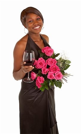 dozen roses - An happy african american woman is posing with her roses and a glass of red wine. Stock Photo - Budget Royalty-Free & Subscription, Code: 400-05730275