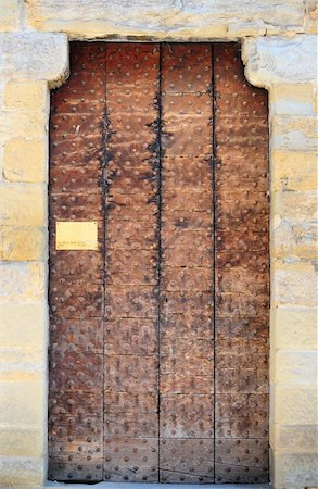 Wooden Ancient Italian Door in Historic Center of Arezzo Stock Photo - Budget Royalty-Free & Subscription, Code: 400-05732237