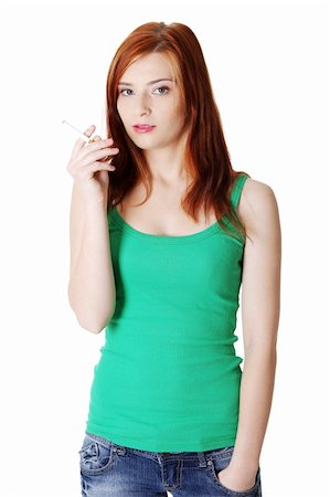 Pretty caucasian standing teen girl holding cigarette. Stock Photo - Budget Royalty-Free & Subscription, Code: 400-05732659