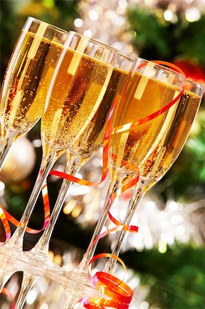 simsearch:400-05749231,k - Several champagne flutes on Christmas background Stock Photo - Budget Royalty-Free & Subscription, Code: 400-05745752