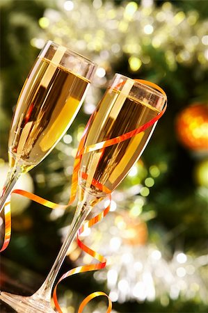 simsearch:400-05749231,k - Two champagne flutes on Christmas background Stock Photo - Budget Royalty-Free & Subscription, Code: 400-05745753