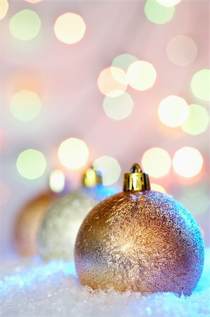 simsearch:400-05749231,k - Golden Christmas baubles in snow against glaring background Stock Photo - Budget Royalty-Free & Subscription, Code: 400-05745814