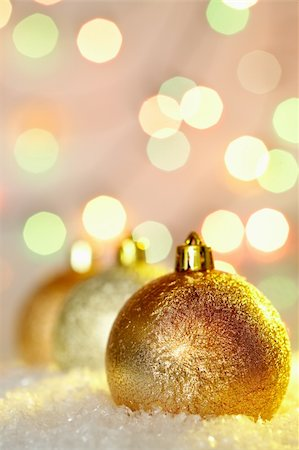simsearch:400-05749231,k - Row of golden Christmas baubles in snow on glaring background Stock Photo - Budget Royalty-Free & Subscription, Code: 400-05745815