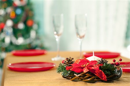 simsearch:400-05749231,k - Image of holiday wreath with flutes and plates at background on Christmas table Stock Photo - Budget Royalty-Free & Subscription, Code: 400-05747353