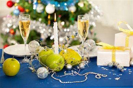 simsearch:400-05749231,k - Image of holiday table with flutes of champagne, fruits, gifts, candle and plates on it Stock Photo - Budget Royalty-Free & Subscription, Code: 400-05747363