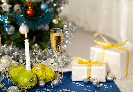 simsearch:400-05749231,k - Image of holiday table with flute of champagne, fruits, gifts, burning candle and decorations on it Stock Photo - Budget Royalty-Free & Subscription, Code: 400-05749224