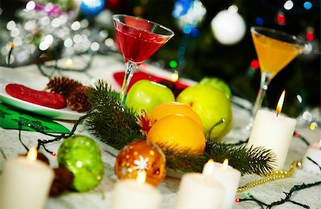 simsearch:400-05749231,k - Image of holiday table with cocktails, fruits, burning candles and decorations on it Stock Photo - Budget Royalty-Free & Subscription, Code: 400-05749229