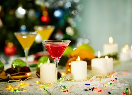 pressmaster - Image of holiday objects: cocktails, burning candles and Christmas decorations Stock Photo - Budget Royalty-Free & Subscription, Code: 400-05749236
