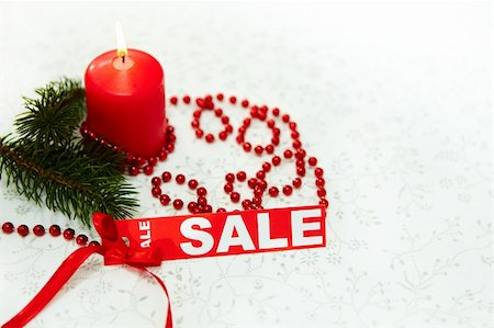 simsearch:400-05749231,k - Image of Christmas composition with burning candle, coniferous branch and red label of sale Stock Photo - Budget Royalty-Free & Subscription, Code: 400-05749239