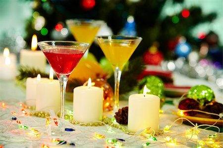 simsearch:400-05749231,k - Image of holiday table with cocktails, burning candles and decorations on it Stock Photo - Budget Royalty-Free & Subscription, Code: 400-05749231