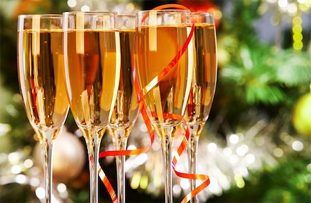 Several champagne flutes on Christmas background Stock Photo - Budget Royalty-Free & Subscription, Code: 400-05749963