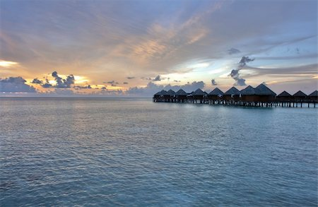 Beautiful vivid sunset over water villas in the Indian ocean, Maldives Stock Photo - Budget Royalty-Free & Subscription, Code: 400-05742451