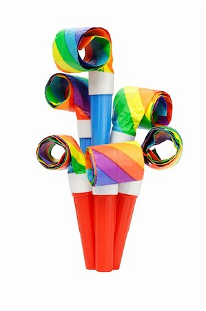 paper blower - Colorful party blowers arranged on white background Stock Photo - Budget Royalty-Free & Subscription, Code: 400-05742674