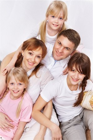 pressmaster - A young friendly family sitting and looking at camera Stock Photo - Budget Royalty-Free & Subscription, Code: 400-05755877