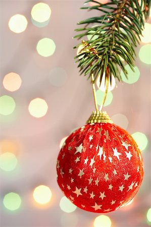 simsearch:400-05749231,k - Red Christmas bauble with golden stars hanging on coniferous branch Stock Photo - Budget Royalty-Free & Subscription, Code: 400-05750005