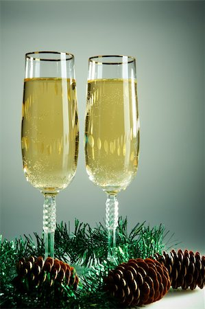 simsearch:400-05749231,k - Two champagne flutes with firtree cones and green tinsel near by Stock Photo - Budget Royalty-Free & Subscription, Code: 400-05750959