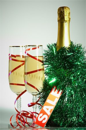simsearch:400-05749231,k - Two champagne flutes with green tinsel, bottle of champagne and sale tag near by Stock Photo - Budget Royalty-Free & Subscription, Code: 400-05750961