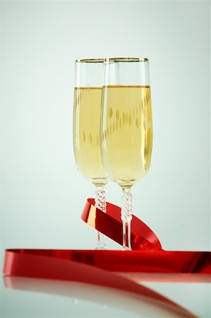 simsearch:400-05749231,k - Two champagne flutes with red ribbon near by Stock Photo - Budget Royalty-Free & Subscription, Code: 400-05750963
