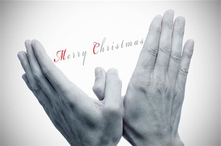 sentence merry christmas and hands in the shape of the dove of peace Stock Photo - Budget Royalty-Free & Subscription, Code: 400-05752132