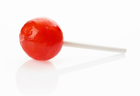 eat lollipop bubblegum - Red lollipop on white background Stock Photo - Budget Royalty-Free & Subscription, Code: 400-05753210