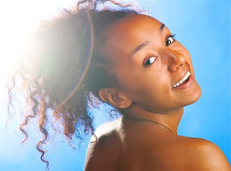 sunny beautiful mulatto woman on sky background Stock Photo - Budget Royalty-Free & Subscription, Code: 400-05875577
