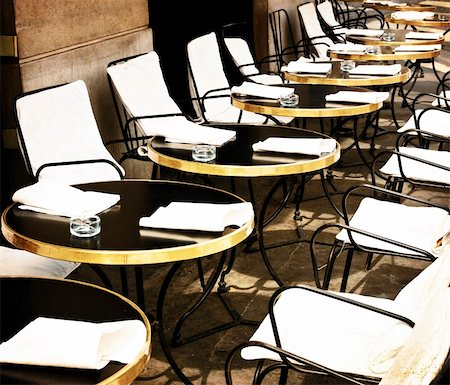 Street view of a Cafe terrace with tables and chairs,paris France Stock Photo - Budget Royalty-Free & Subscription, Code: 400-05877612