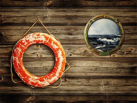 sailing boat storm - lifebuoy and porthole with sea view Stock Photo - Budget Royalty-Free & Subscription, Code: 400-05878112