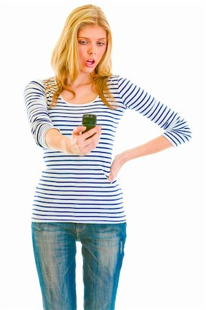 Surprised teen girl looking on mobile phone Stock Photo - Budget Royalty-Free & Subscription, Code: 400-05888433