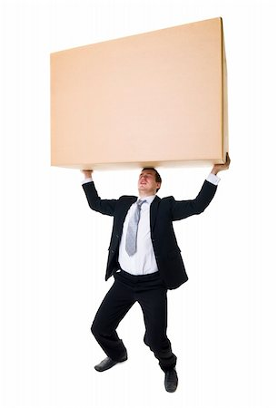 Well dressed man carrying a heavy cardboard Box isolated on white background Stock Photo - Budget Royalty-Free & Subscription, Code: 400-05889497