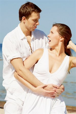 Amazed young couple on a beach Stock Photo - Budget Royalty-Free & Subscription, Code: 400-05881203