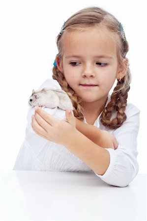 Wait you little devil - little girl catching her runaway hamster Stock Photo - Budget Royalty-Free & Subscription, Code: 400-05882560