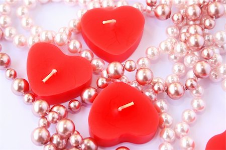 simsearch:400-04863562,k - Heart shape red candles and necklace isolated on grey background. Stock Photo - Budget Royalty-Free & Subscription, Code: 400-05882680