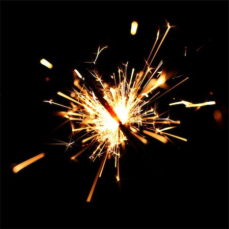 sparks with white background - holiday sparkler macro close up Stock Photo - Budget Royalty-Free & Subscription, Code: 400-05882907