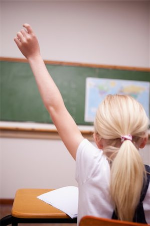 back view of a schoolgirl raising her hand in a classroom Stock Photo - Budget Royalty-Free & Subscription, Code: 400-05896357