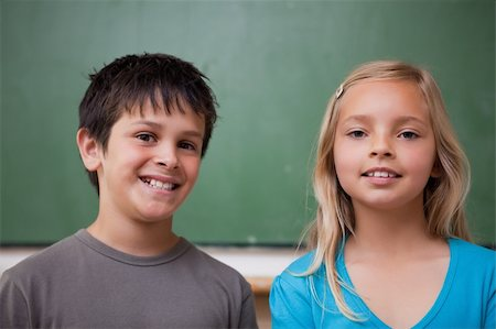 Pupils posing together in front of a chalkboard Stock Photo - Budget Royalty-Free & Subscription, Code: 400-05896514