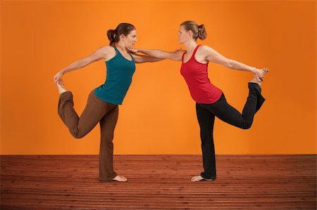 feet gymnast - Two Caucasian women perform yogasana over orange background Stock Photo - Budget Royalty-Free & Subscription, Code: 400-05898844