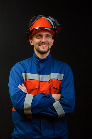 pzromashka (artist) - The worker in overalls and a helmet on a black background Stock Photo - Budget Royalty-Free & Subscription, Code: 400-05898878