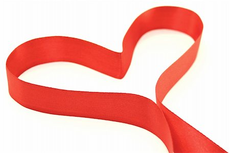 Beautiful heart from red satin ribbon on a white background Stock Photo - Budget Royalty-Free & Subscription, Code: 400-05899118