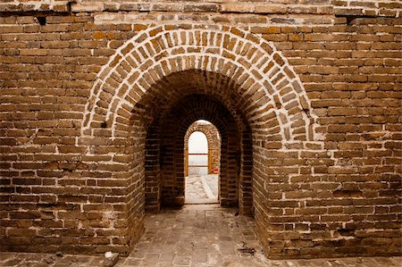 An architectural details view looking through the arches of one of the guard towers on the landmark Great Wall of China Stock Photo - Budget Royalty-Free & Subscription, Code: 400-05890177