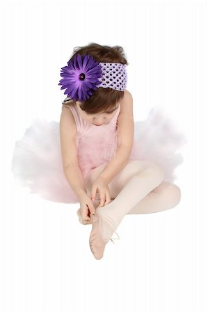Little ballet girl putting on her shoes Stock Photo - Budget Royalty-Free & Subscription, Code: 400-05890844