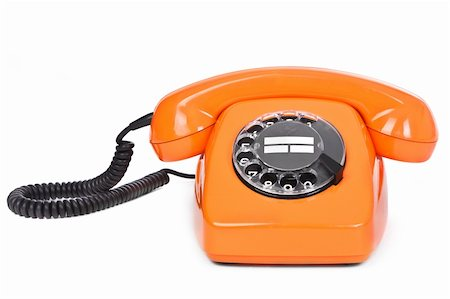 classic dial phone on white background Stock Photo - Budget Royalty-Free & Subscription, Code: 400-05891347